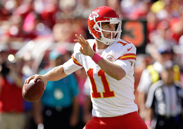 Alex Smith looks for a target.