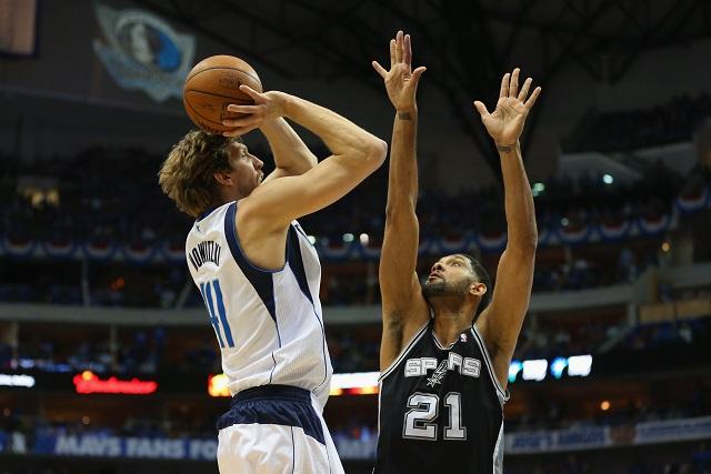 Dirk Nowitzki shoots over Tim Duncan.