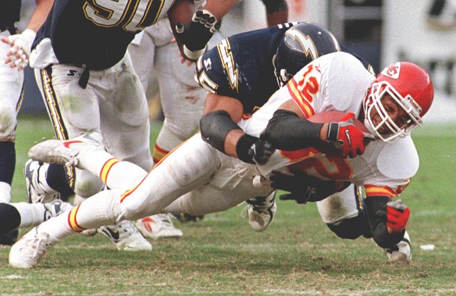 SAN DIEGO, : Kansas City Chiefs running back Marcus Allen is brought down by San Diego Chargers Junior Seau after a short gain in the 3rd quarter 14 December. Allen scored a touchdown in the 2nd quarter to help the Chiefs defeat the Chargers 29 to 7 and improved their record to 12-3. AFP PHOTO/Mike NELSON (Photo credit should read MIKE NELSON/AFP/Getty Images)Mike Nelson/AFP/Getty Images