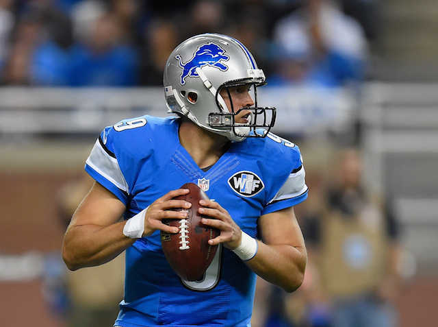 Matthew Stafford looks for a target in the backfield.