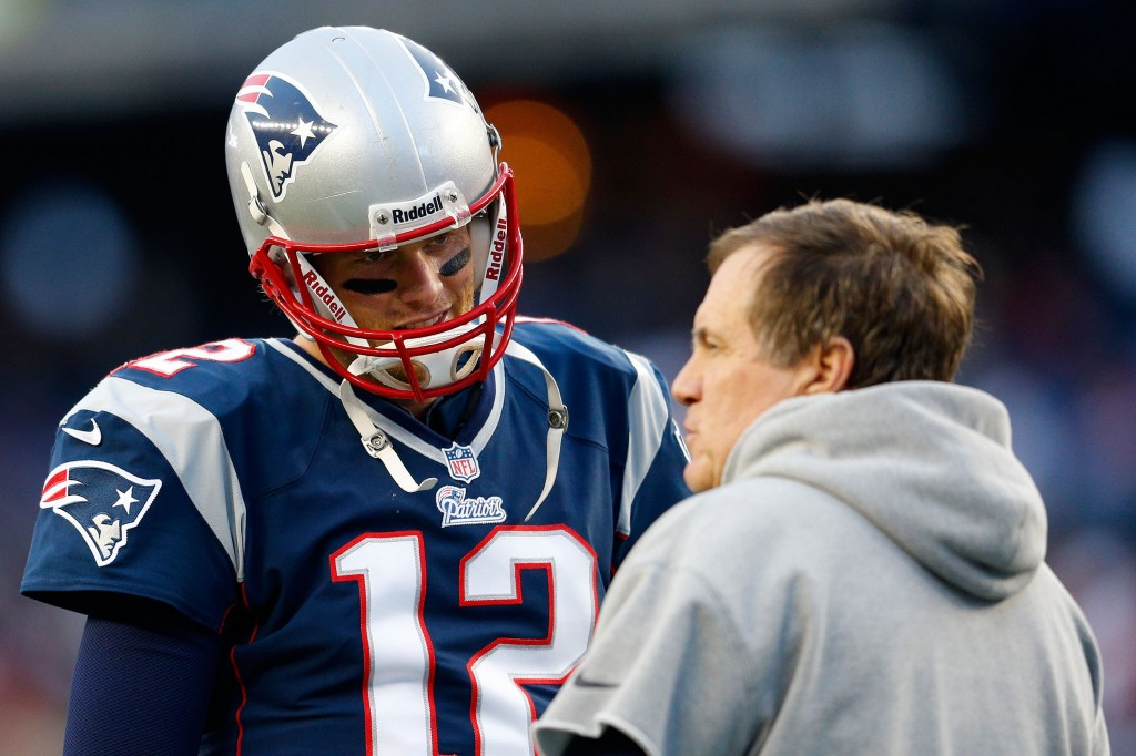 Tom Brady talks to head coach Bill Belichick.