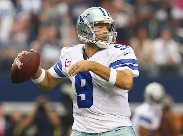 Tony Romo looks to throw.