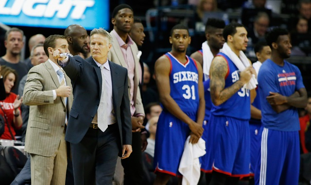 The 76ers look dejected after a loss.