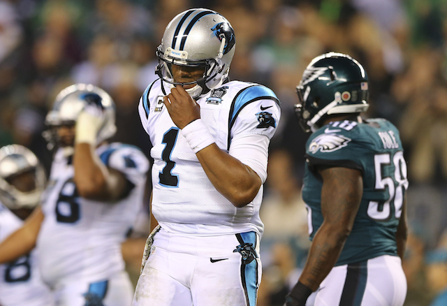 Cam Newton reacts after throwing an incomplete pass against the Eagles