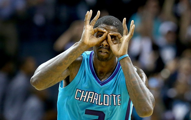 Marvin Williams holding his hands to his face