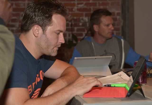 VENICE, CA - SEPTEMBER 02: Actor Scott Porter enters his pick on a Microsoft Surface during The Microsoft Entertainment Fantasy Football Draft at The Microsoft Lounge on September 2, 2014 in Venice, California.