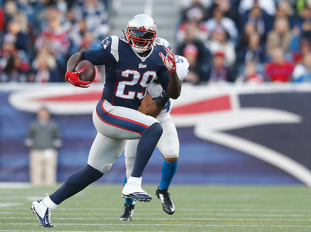 LeGarrette Blount grips the ball and makes a run for it.