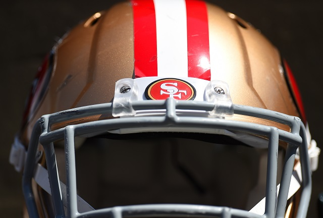 A San Francisco 49ers helmet rests on a stand
