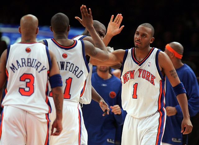 Stephon Marbury of the New York Knicks high-fives his teammates.