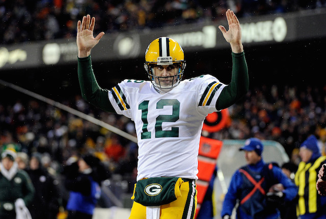 Aaron Rodgers acknowledges a touchdown against the Bears
