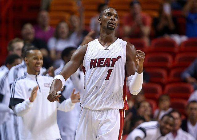 Chris Bosh reacts to a play in the preseason
