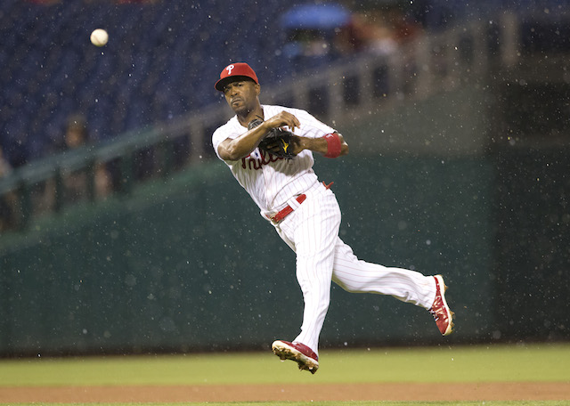 Jimmy Rollins throws the ball from the outfield.