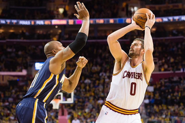 Kevin Love shoots over David West