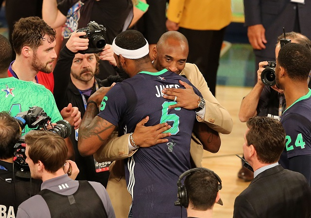 Kobe Bryant and LeBron James hug after an All-Star game.