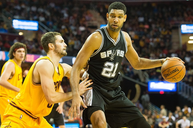 CLEVELAND, OH - NOVEMBER 19: Kevin Love #0 of the Cleveland Cavaliers puts pressure on Tim Duncan #21 of the San Antonio Spurs during the first half at Quicken Loans Arena on November 19, 2014 in Cleveland, Ohio. (Photo by Jason Miller/Getty Images)