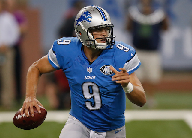 Matthew Stafford about to throw on the run