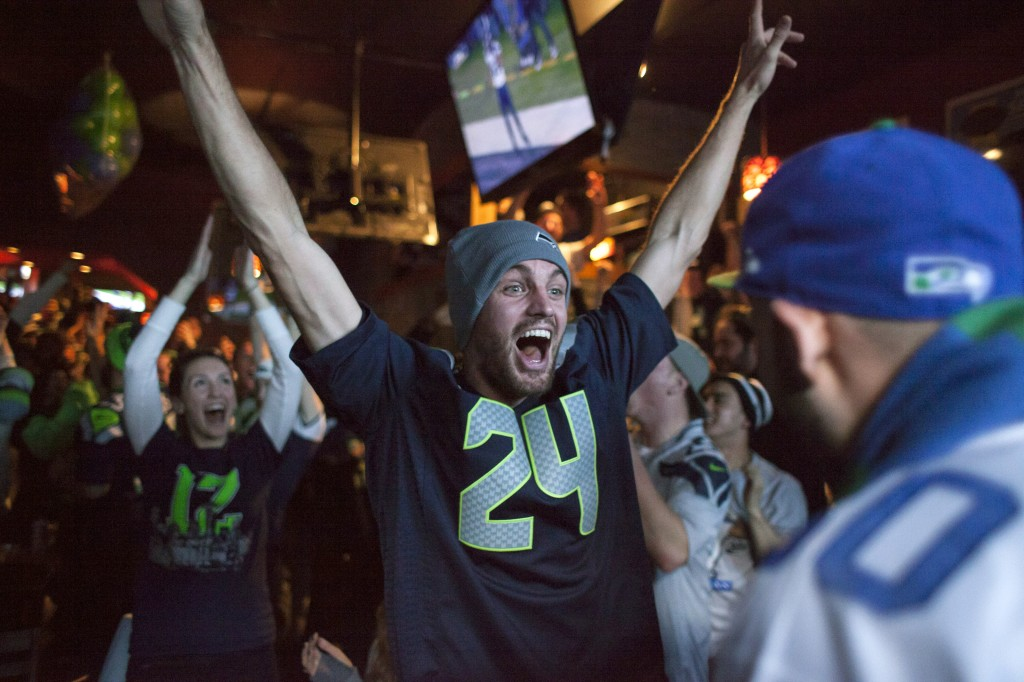 Seattle Seahawks fans watch and celebrate.