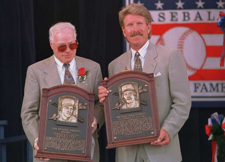 COOPERSTOWN, NY - JULY 30: Richie Ashburn (L) and Mike Schmidt (R) hold their plaques after their induction into the National Baseball Hall of Fame 30 July in Cooperstown, NY. The two former Philadelphia Phillies joined a total of five inductees in today's ceremony.