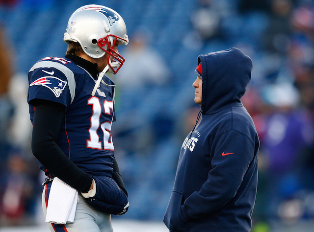 FOXBORO, MA - JANUARY 10: Tom Brady #12 and head coach Bill Belichick of the New England Patriots talk before the 2014 AFC Divisional Playoffs game against the Baltimore Ravens at Gillette Stadium on January 10, 2015 in Foxboro, Massachusetts. (Photo by Jim Rogash/Getty Images)