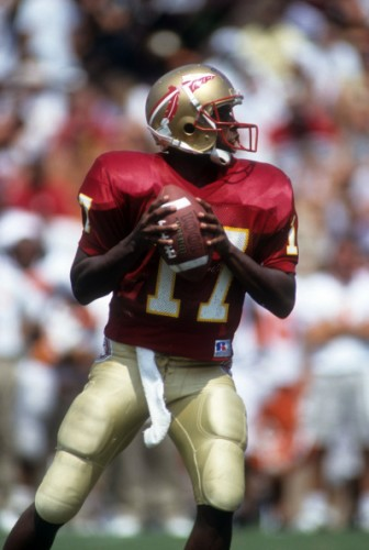 Charlie Ward looks for a target down the field.