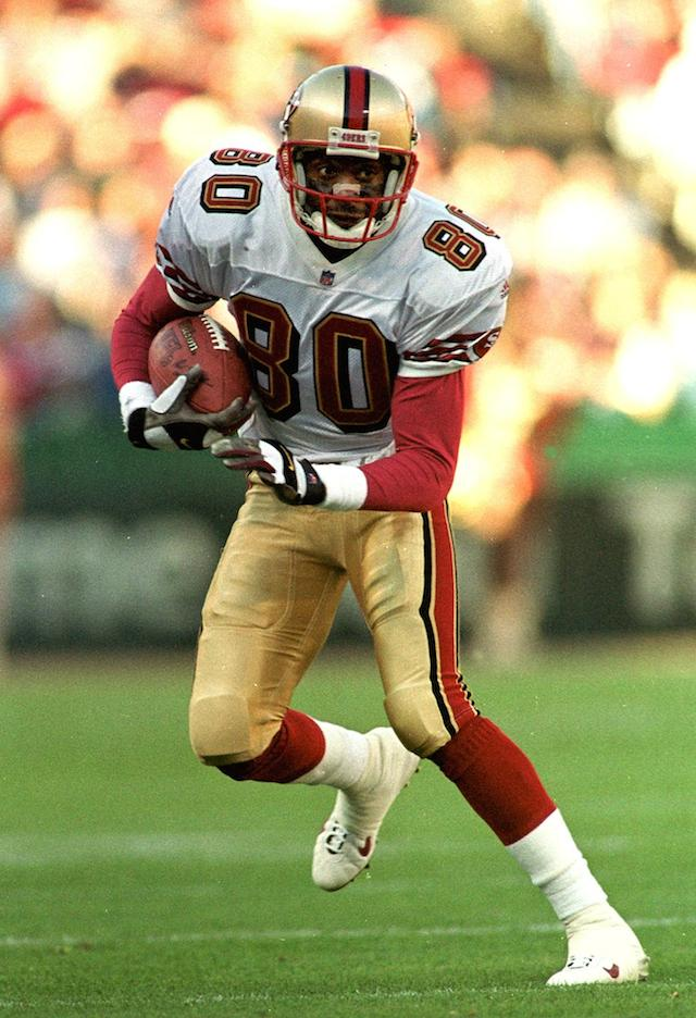Jerry Rice dodges the defenders.