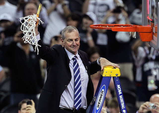 Jim Calhoun cuts down the nets.