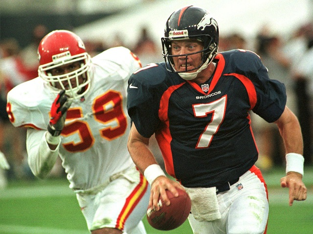 DENVER, CO - JULY 8: Denver Broncos quarterback John Elway scrambles for yardage as he is pursued by Kansas City Chiefs linebacker Donnie Edwards during the Broncos season opener against the Chiefs 31 August in Denver, Colorado. The Broncos won 19-3.