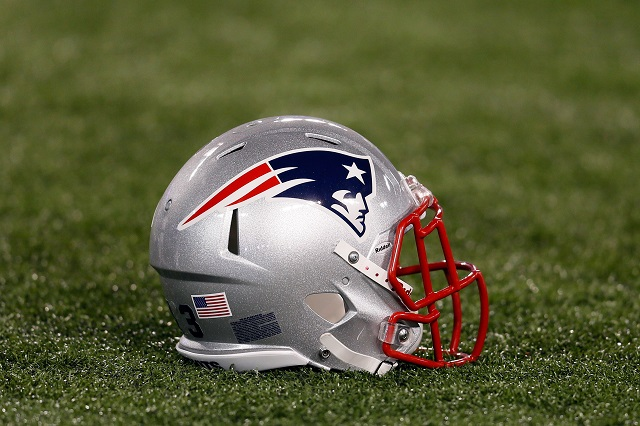 A New England helmet rests on the field.
