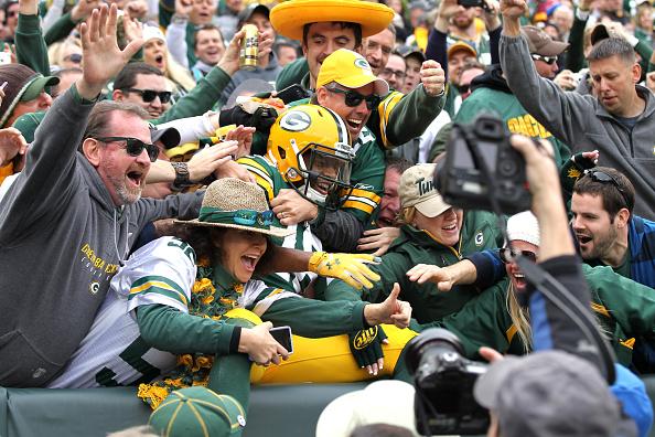 Green Bay fans celebrate a touchdown.