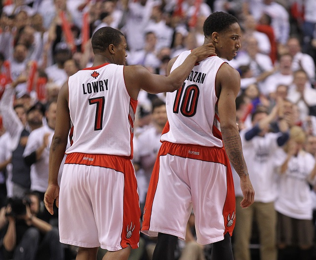 Kyle Lowry and DeMarcus DeRozan walk off the court together.