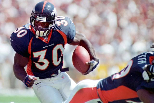 Broncos running back Terrell Davis looks for an opening in the Green Bay defense.