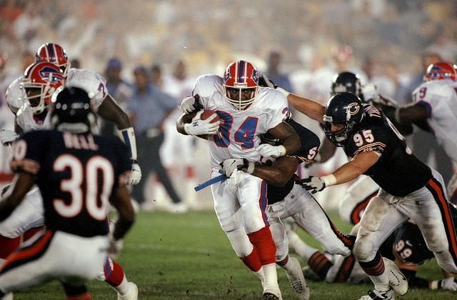 Thurman Thomas plows through a hole in the Chicago Bears defense.