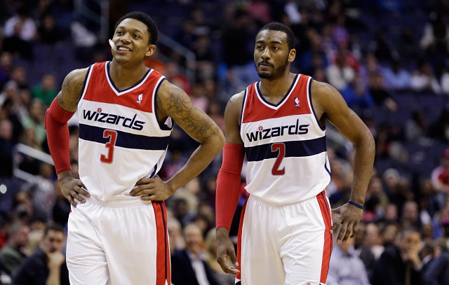 Bradley Beal (L) and and John Wall of the Washington Wizards talk during a free throw