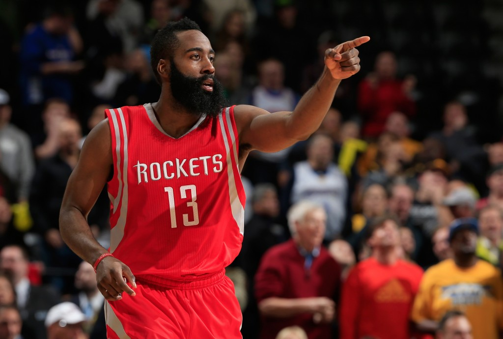 James Harden #13 of the Houston Rockets celebrates as he heads up court after scoring against the Denver Nuggets at Pepsi Center on December 17, 2014 in Denver, Colorado. The Rockets defeated the Nuggets 115-111 in overtime. NOTE TO USER: User expressly acknowledges and agrees that, by downloading and or using this photograph, User is consenting to the terms and conditions of the Getty Images License Agreement. (Photo by Doug Pensinger/Getty Images)