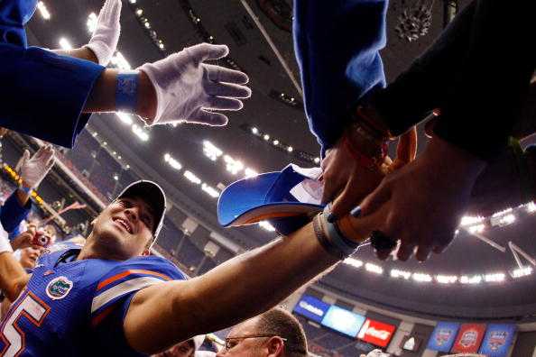Tim Tebow greets fans at Florida.
