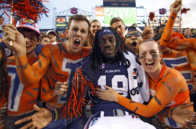 Fans painted like the Auburn Tiger celebrate a touchdown with former Auburn wide receiver Sammie Coates