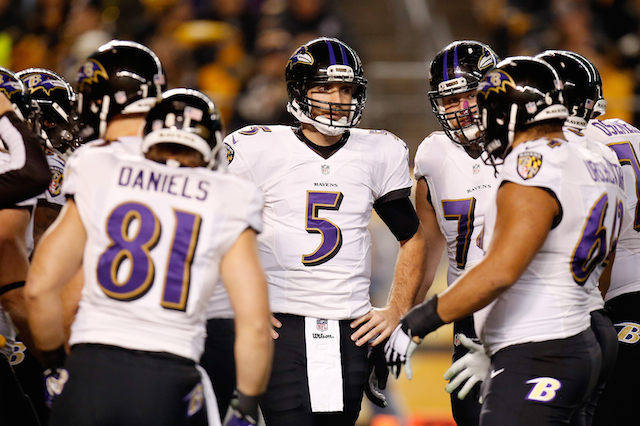 PITTSBURGH, PA - JANUARY 03: Joe Flacco #5 of the Baltimore Ravens huddles with his team in the first quarter against the Pittsburgh Steelers during their AFC Wild Card game at Heinz Field on January 3, 2015 in Pittsburgh, Pennsylvania. (Photo by Gregory Shamus/Getty Images)