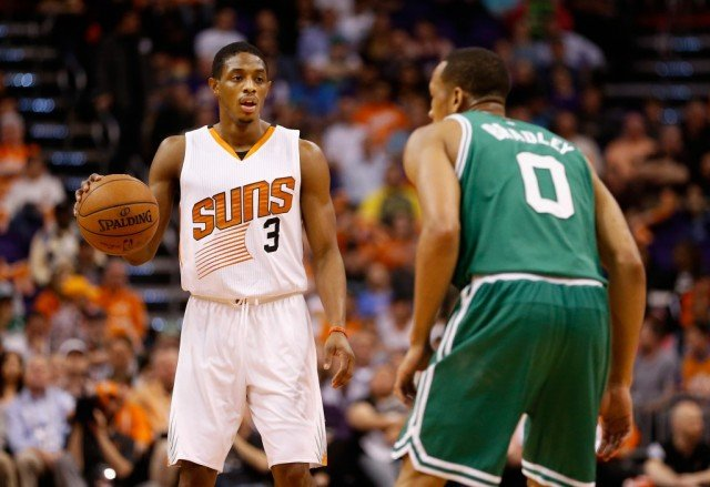 Brandon Knight handles the ball against Avery Bradley