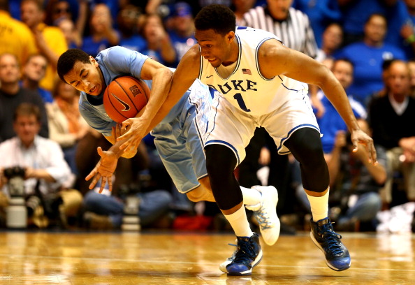 The North Carolina Tar Heels and Duke Blue Devils battle on the court.