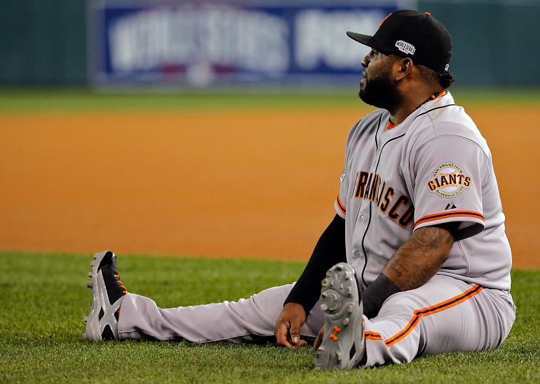 Pablo Sandoval of the San Francisco Giants stretching on the field.