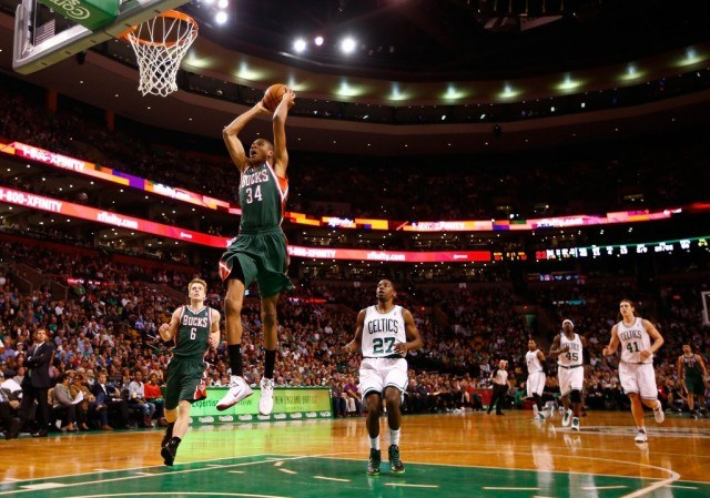 Giannis Antetokounmpo of the Milwaukee Bucks flies through the air for a dunk | Jared Wickerham/Getty Images