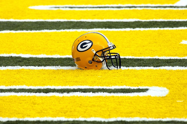 A Green Bay helmet rests on the field.
