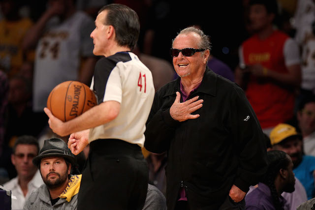 Jack Nicholson harasses the referee from the sidelines.