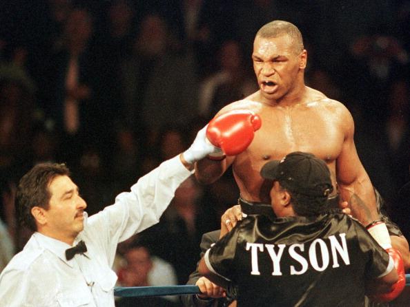 Mike Tyson celebrates winning