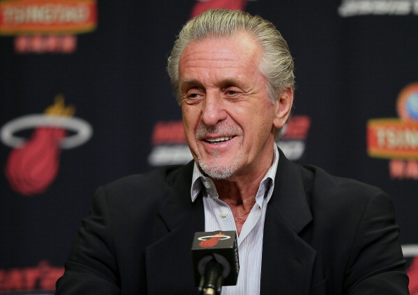 Pat Riley responds to media questions at a press conference.