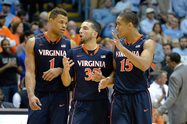 Virginia players chat during a timeout
