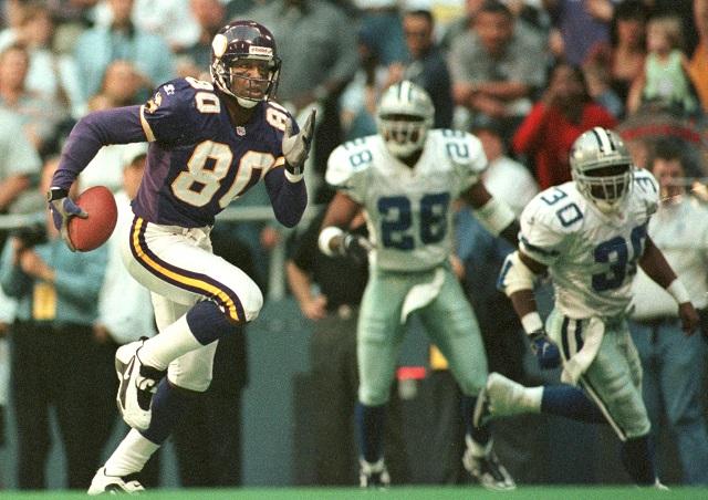 Cris Carter sprints for a touchdown.
