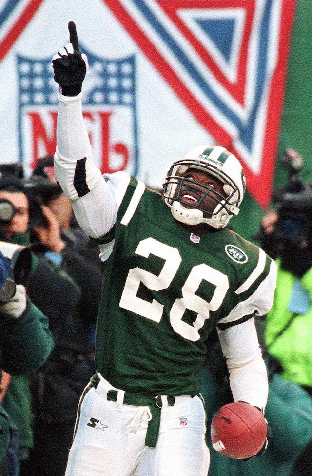 Curtis Martin points upward after winning a game.