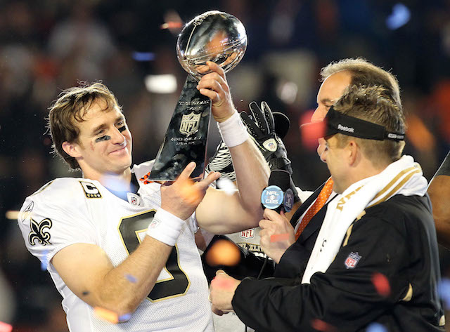 Drew Brees holds the Lombardi Trophy.