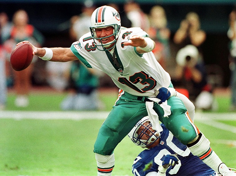Miami Dolphins quarterback Dan Marino (TOP) is sac